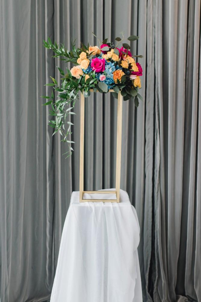 styled shoot bold colors room 1520 flower arrangement altar