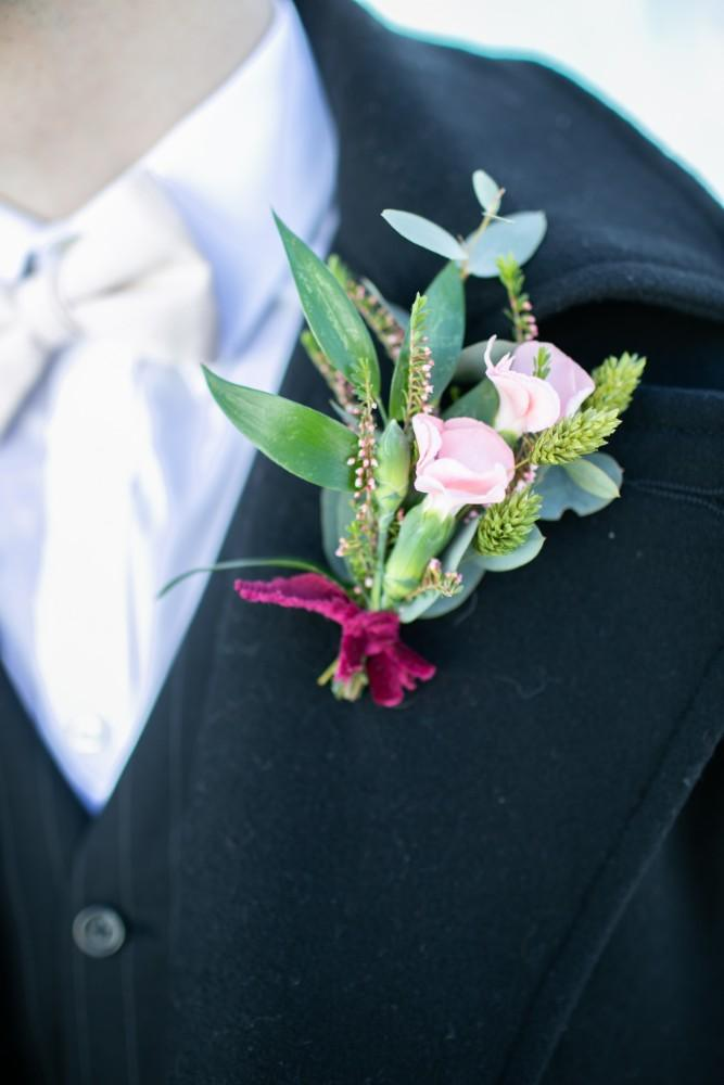 ice castles styled shoot groom boutonniere