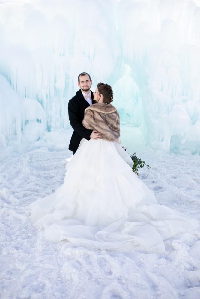 ice castles styled shoot bride groom fur