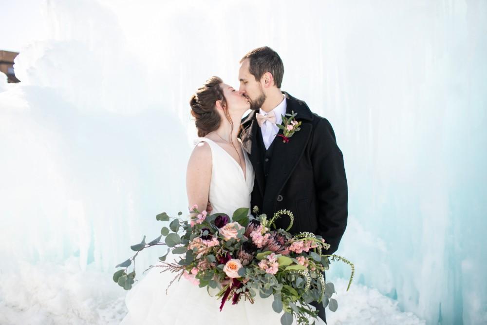 ice castles styled shoot bride groom kiss