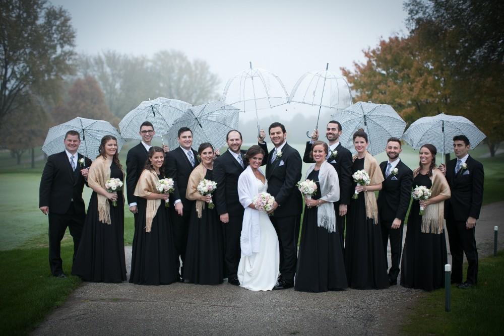amanda bradley wedding party rain umbrellas