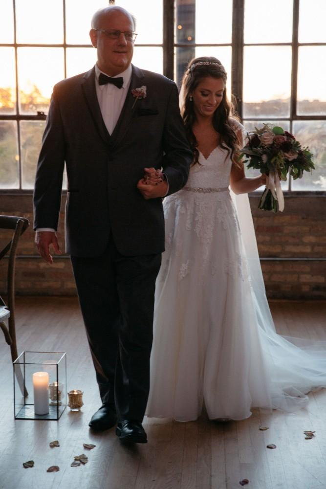 brittany greg ravenswood event center father walking bride down aisle