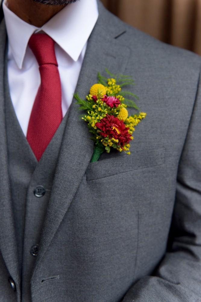 elizabeth & tony at volo wine bar groom boutonniere