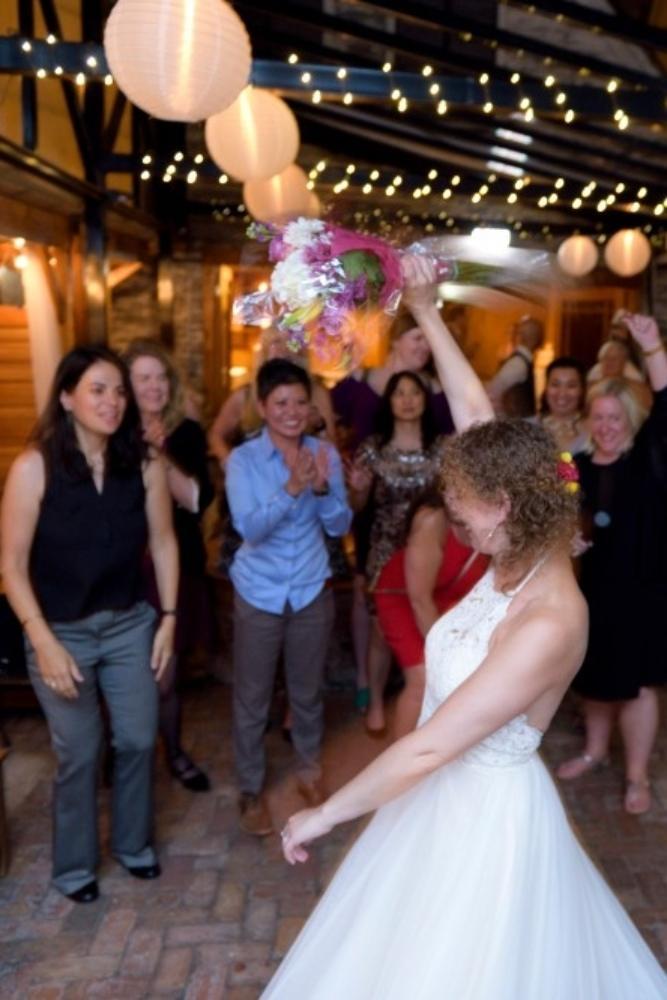 elizabeth & tony at volo wine bar bouquet toss