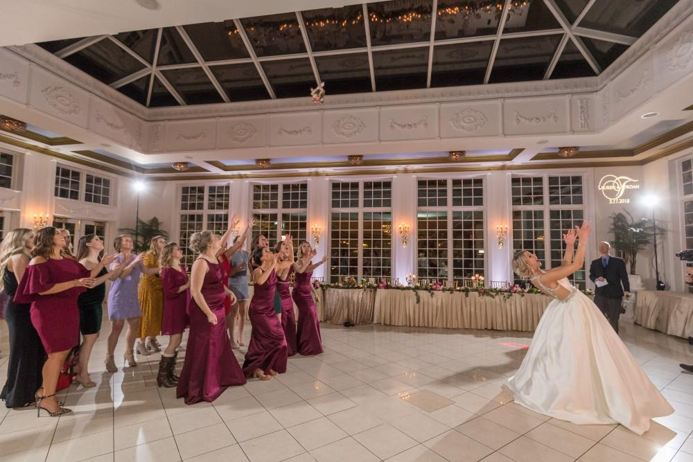 lauren and jordan haley mansion bouquet toss