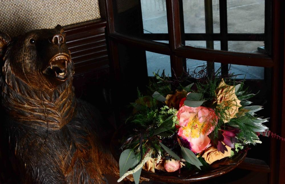 steakhouse styled shoot bear with flowers