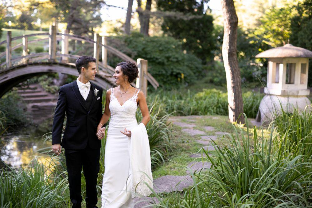 andrea matthew cotillion banquets bride and groom portrait by a bridge