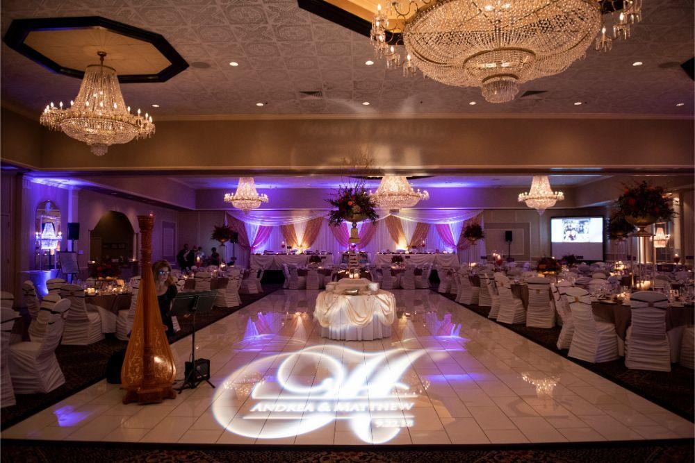 andrea matthew cotillion banquets wedding reception white monogram on floor