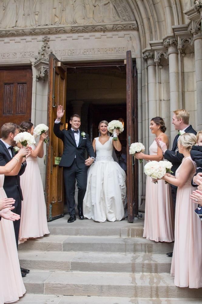 katrina drew the drake chicago wedding bride and groom leaving church