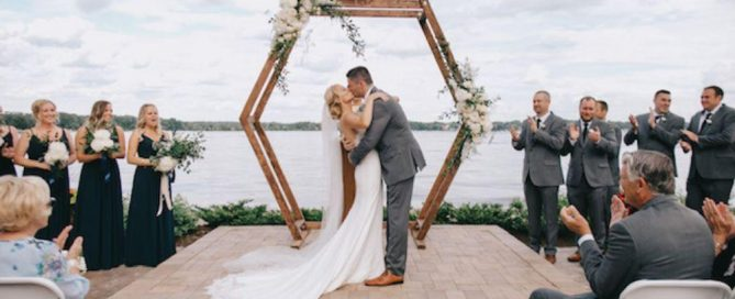 bohemian wedding arch hexagon arch with minimal flowers summer 2019 wedding trends