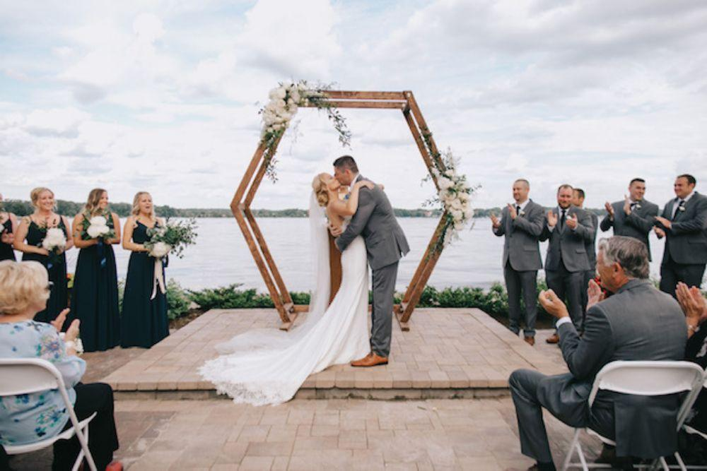bohemian wedding arch hexagon arch with minimal flowers summer 2019 wedding trends