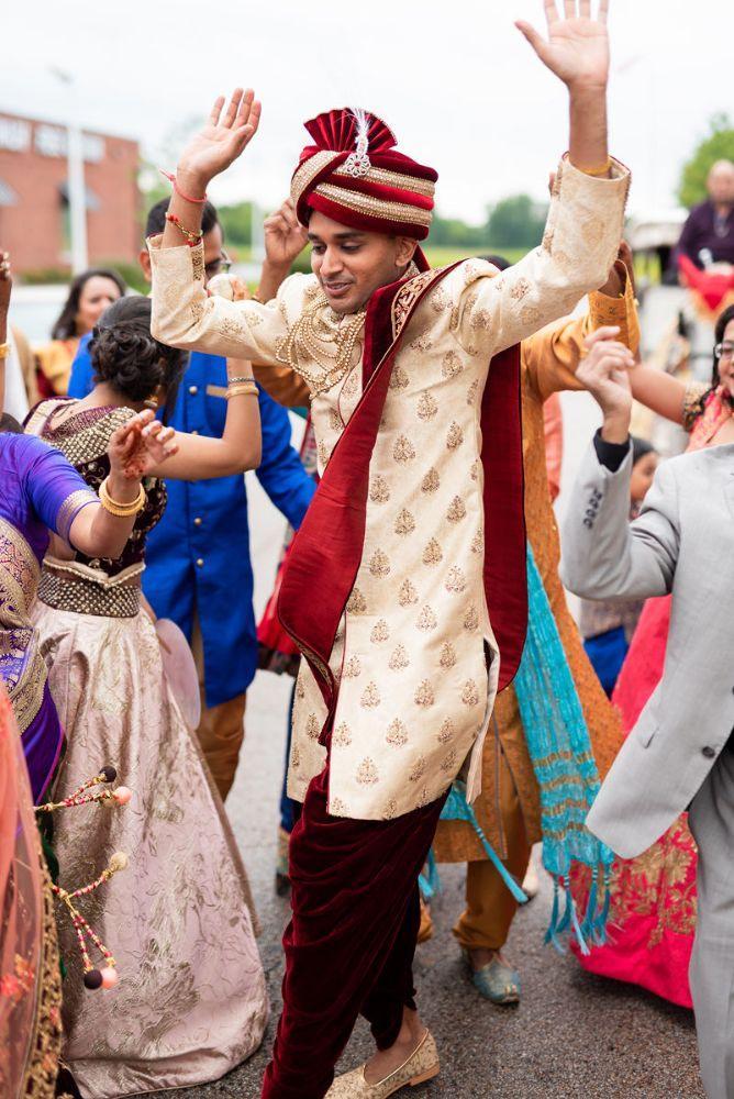 kajal akash pearl banquets & conference center groom dancing arriving at wedding ceremony