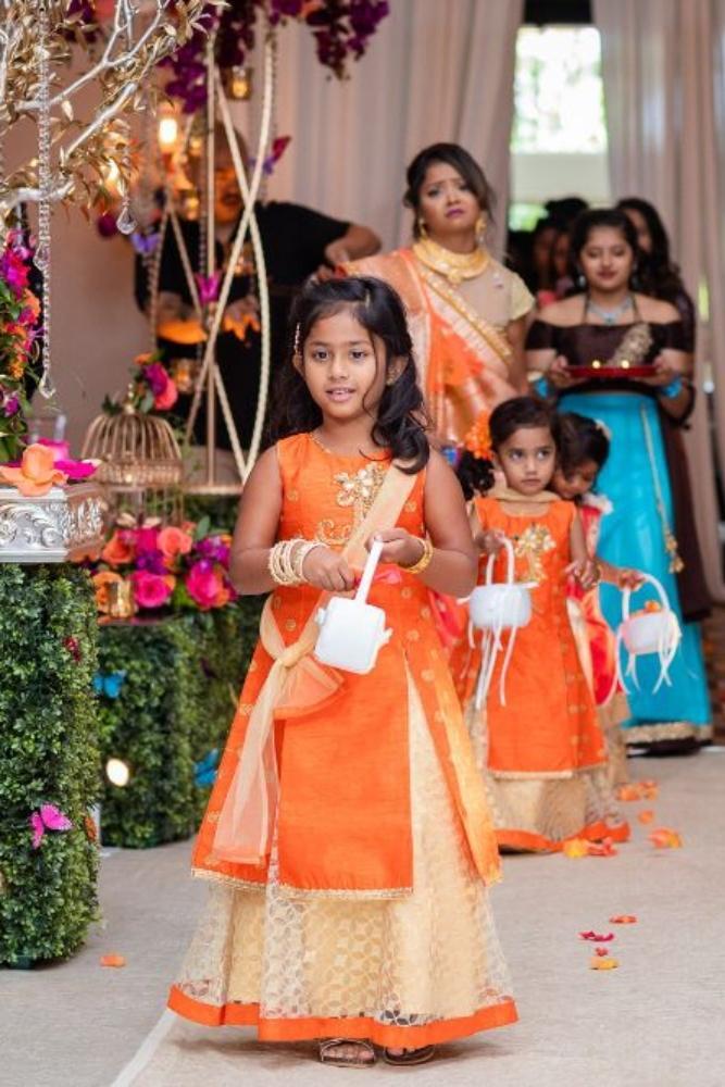 kajal akash pearl banquets & conference center flower girls in orange saris