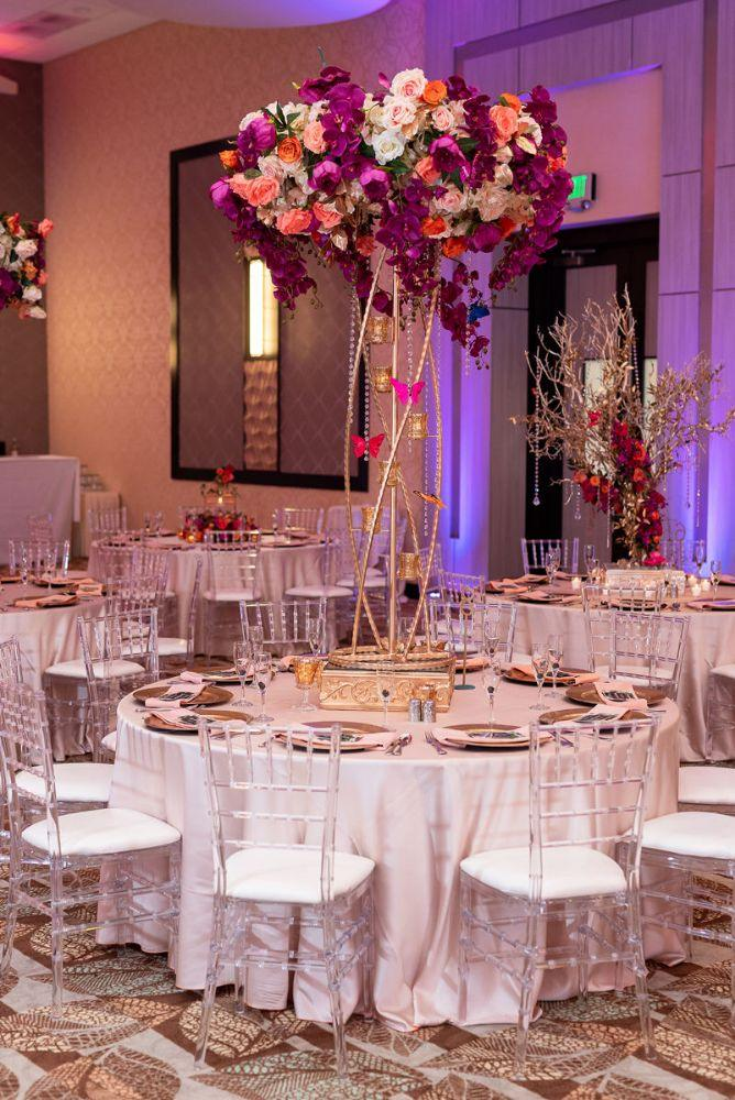 kajal akash pearl banquets & conference center wedding reception tall floral centerpieces