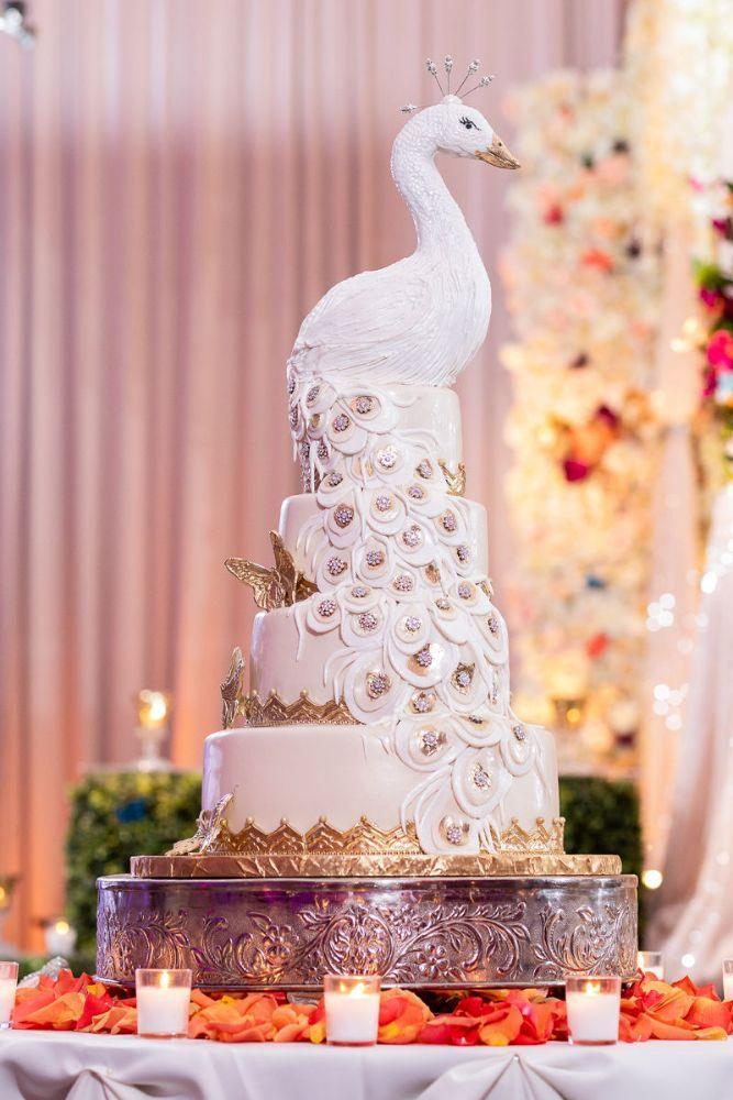 kajal akash pearl banquets & conference center white peacock wedding cake