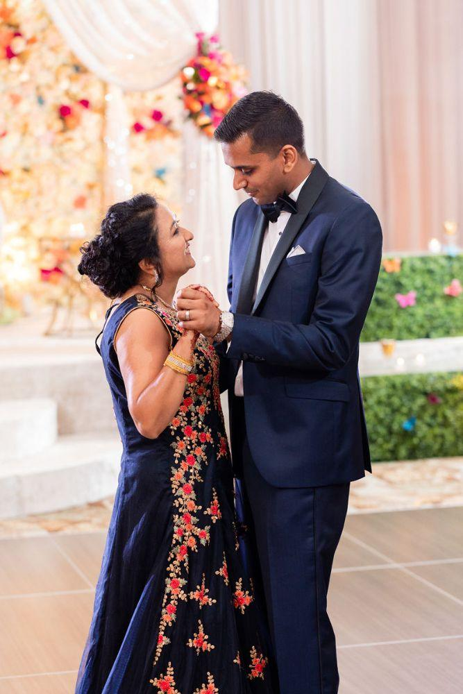 kajal akash pearl banquets & conference center groom and mother dancing