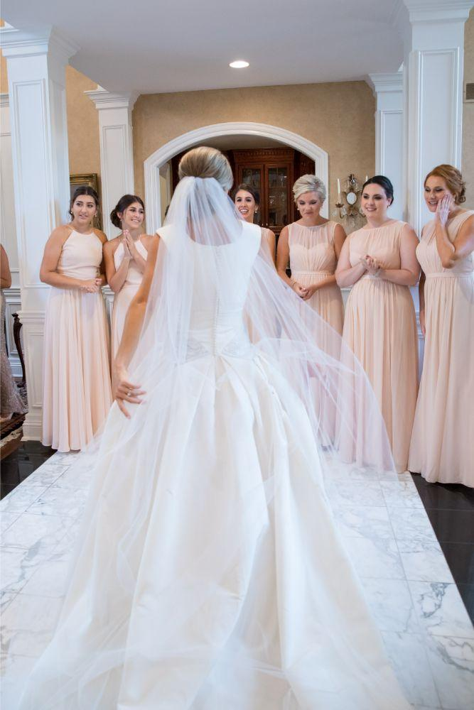 katrina drew the drake chicago wedding first look with bridal party