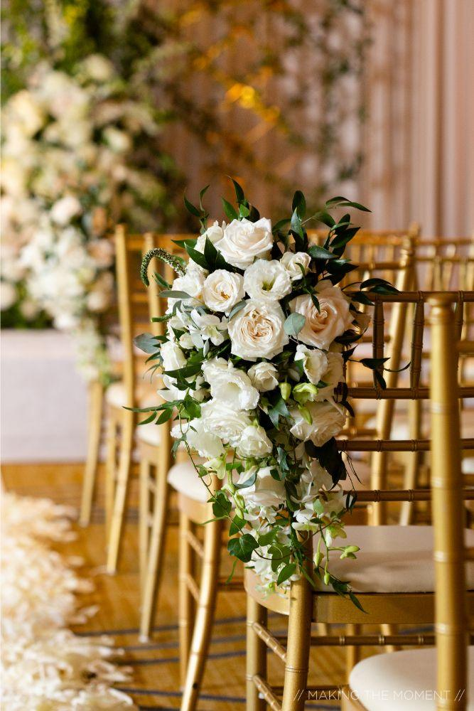 grace nicholas the hyatt lodge oak brook, IL white flowers on natural chairs wedding ceremony
