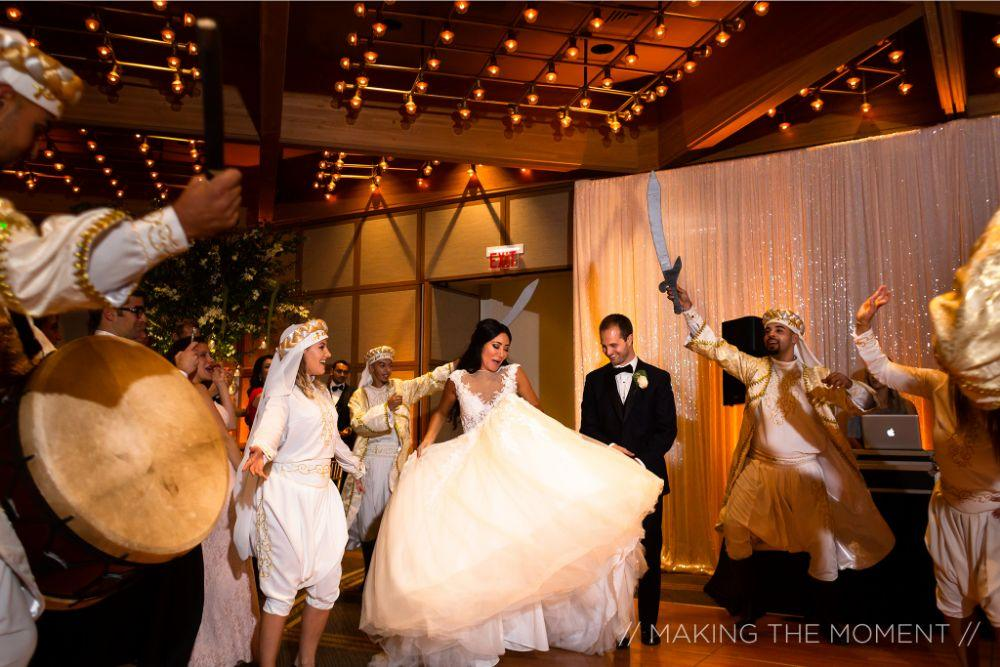 grace nicholas the hyatt lodge oak brook, IL bride and groom entrance to reception