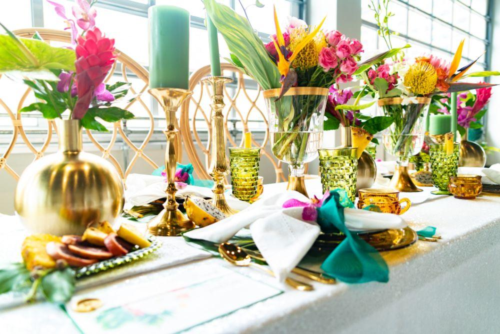 vibrant tropical paradise wedding inspiration at gallery 1500 reception table centerpieces