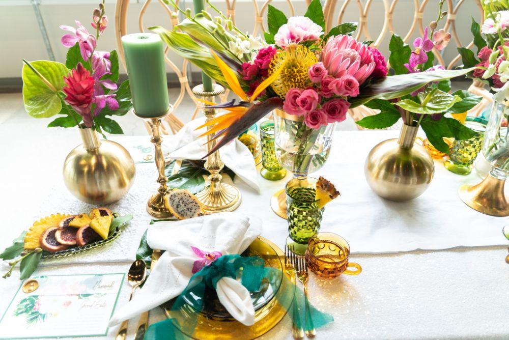 vibrant tropical paradise wedding inspiration at gallery 1500 reception table place setting