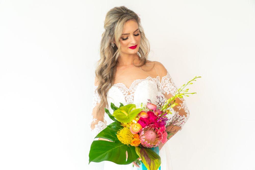 vibrant tropical paradise wedding inspiration at gallery 1500 bride with vibrant bouquet