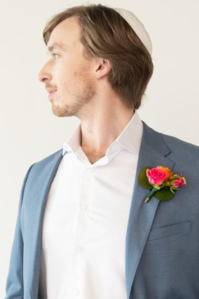 vibrant tropical paradise wedding inspiration at gallery 1500 groom with vibrant boutonniere