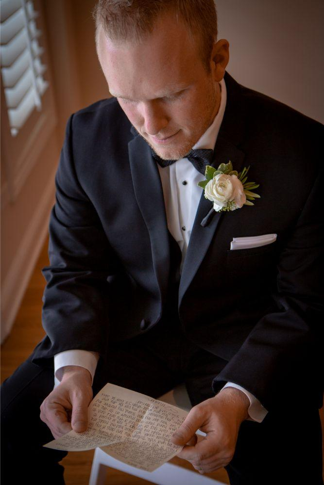 megan mike hotel indigo naperville rivewalk chicago wedding groom reading letter from bride