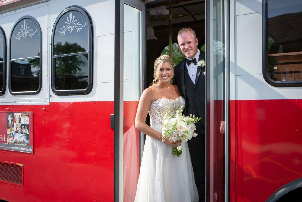 megan mike hotel indigo naperville rivewalk chicago wedding bride and groom on trolley