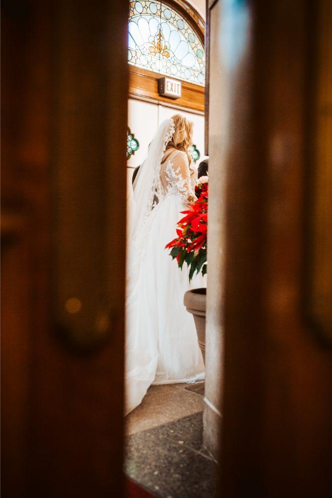 adrianna dean salvatore's chicago wedding bride getting ready through door