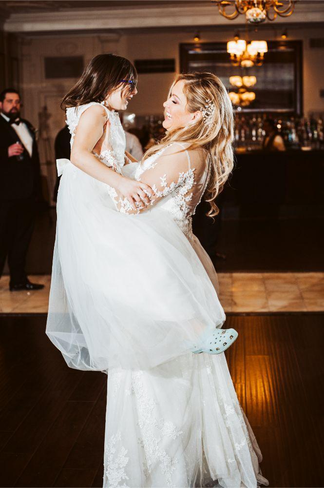 adrianna dean salvatore's chicago wedding bride dancing with flower girl