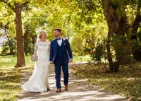 kolby j chicago wedding photography couple walking on tree-lined path