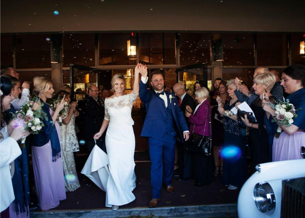 kolby j chicago wedding photography bride and groom church exit