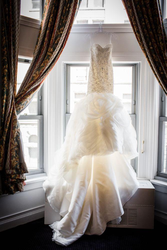 michelle jimmy the congress plaza hotel chicago wedding dress in window
