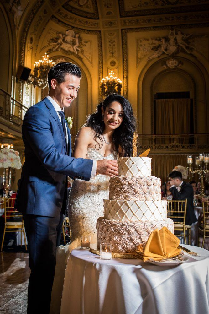 michelle jimmy the congress plaza hotel chicago wedding cutting cake
