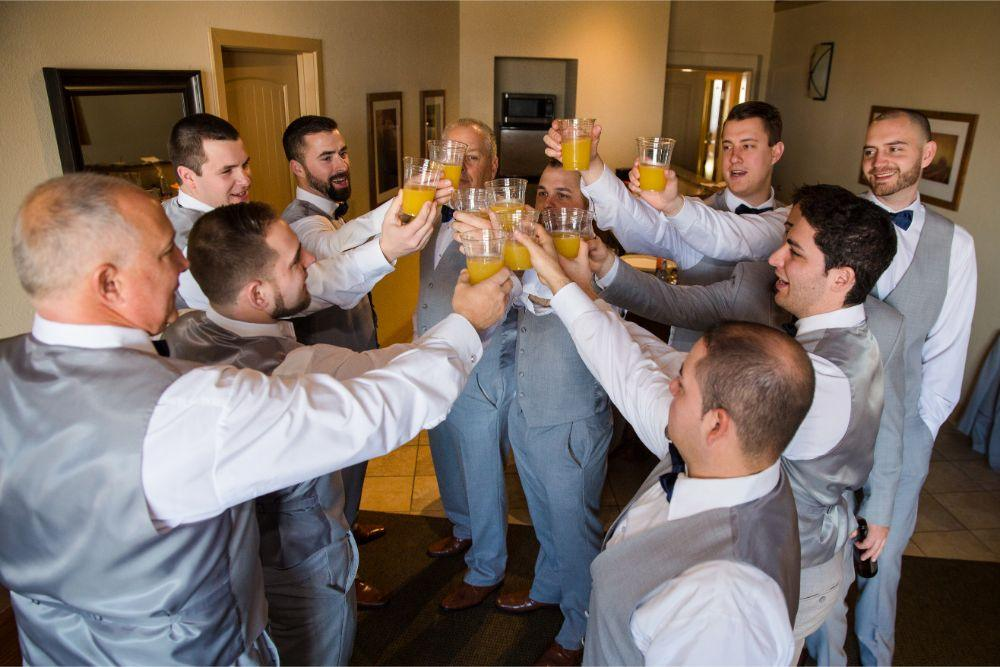 brittany matthew local love the ridge hotel chicago wedding groom getting ready cheers with groomsmen