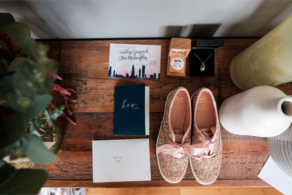 local love kaitlyn tom lacuna lofts chicago, il wedding detail flat lay