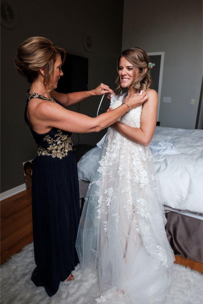 local love kaitlyn tom lacuna lofts chicago, il wedding mother helping bride get ready