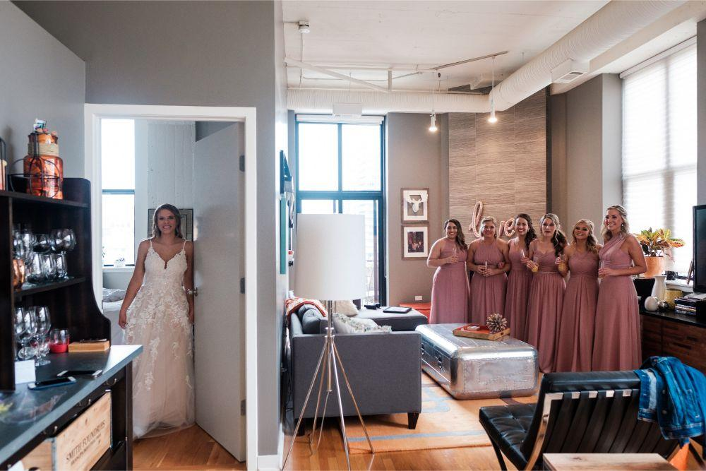 local love kaitlyn tom lacuna lofts chicago, il wedding bridesmaids seeing bride for the first time