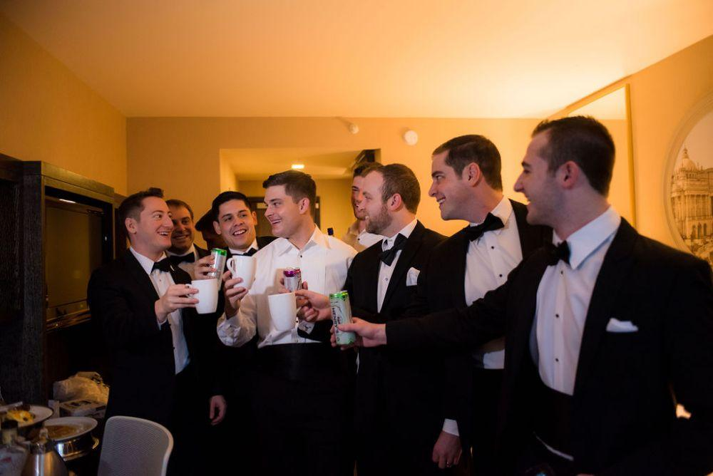 sarah chris galleria marchetti chicago, il wedding groom and groomsmen getting ready cheers