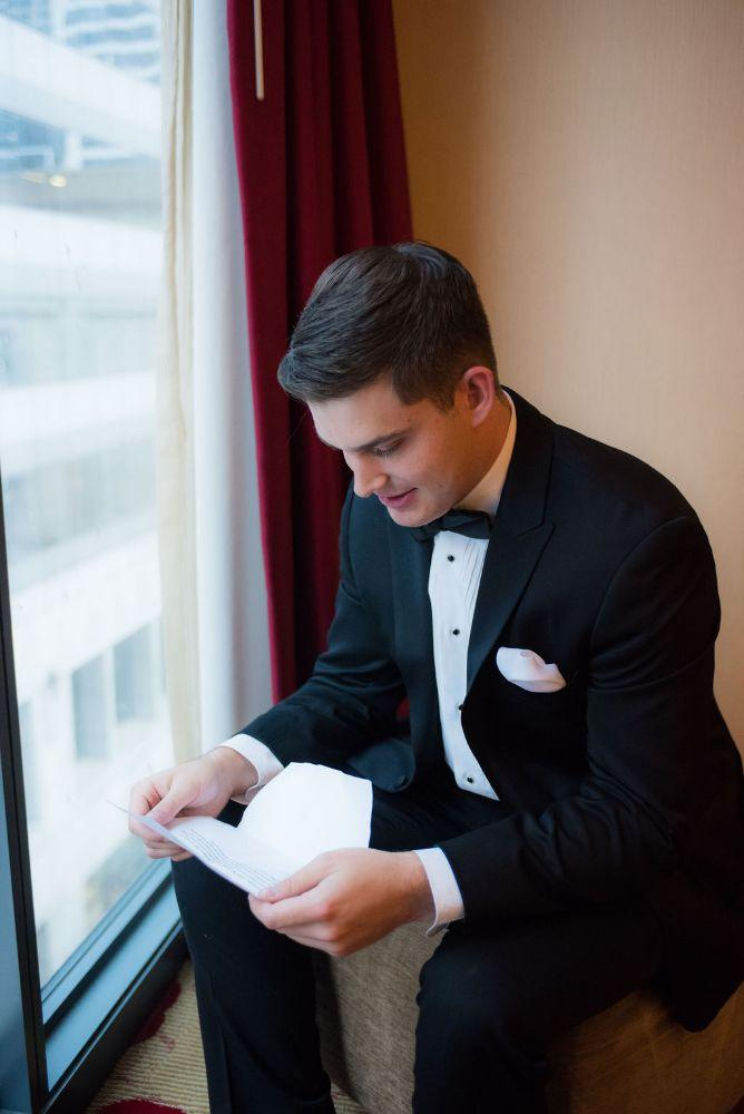 sarah chris galleria marchetti chicago, il wedding groom getting ready reading letter from bride