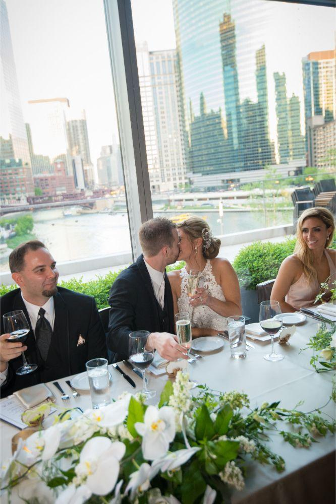 jana matt gibsons steakhouse chicago, il wedding toasts bride and groom kiss