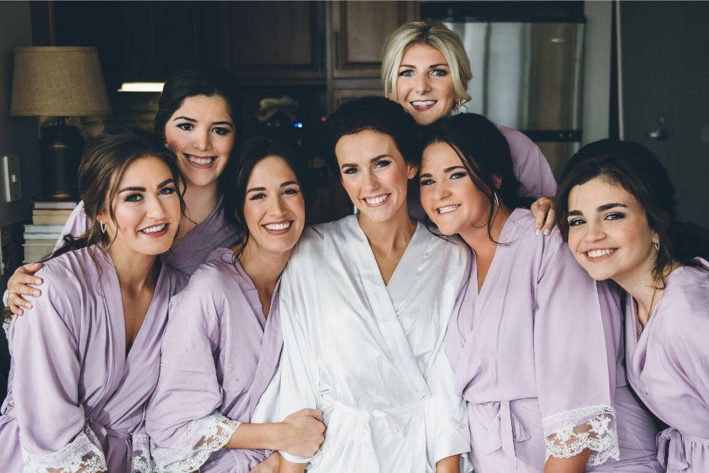 kelly alex local love skyline loft chicago, il wedding bride and bridesmaids getting ready robes
