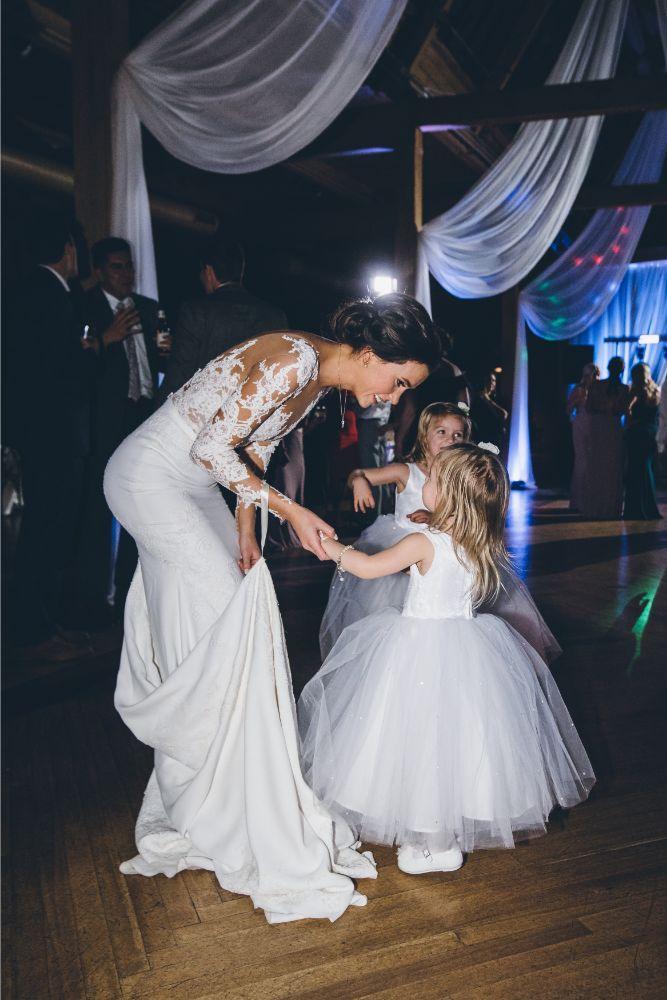 kelly alex local love skyline loft chicago, il wedding bride dancing with flower girls