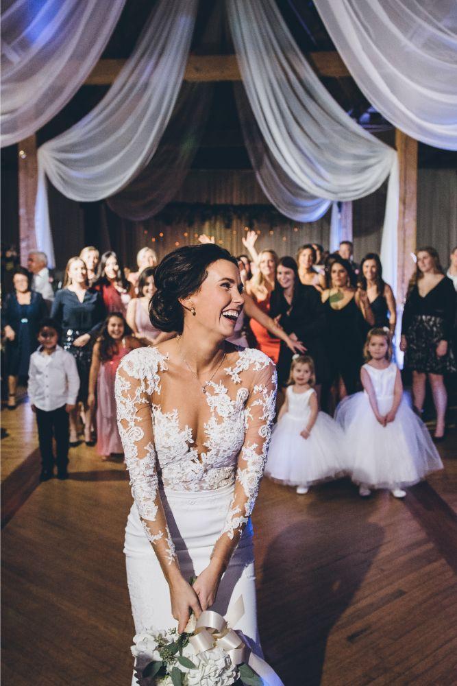 kelly alex local love skyline loft chicago, il wedding bride throwing bouquet